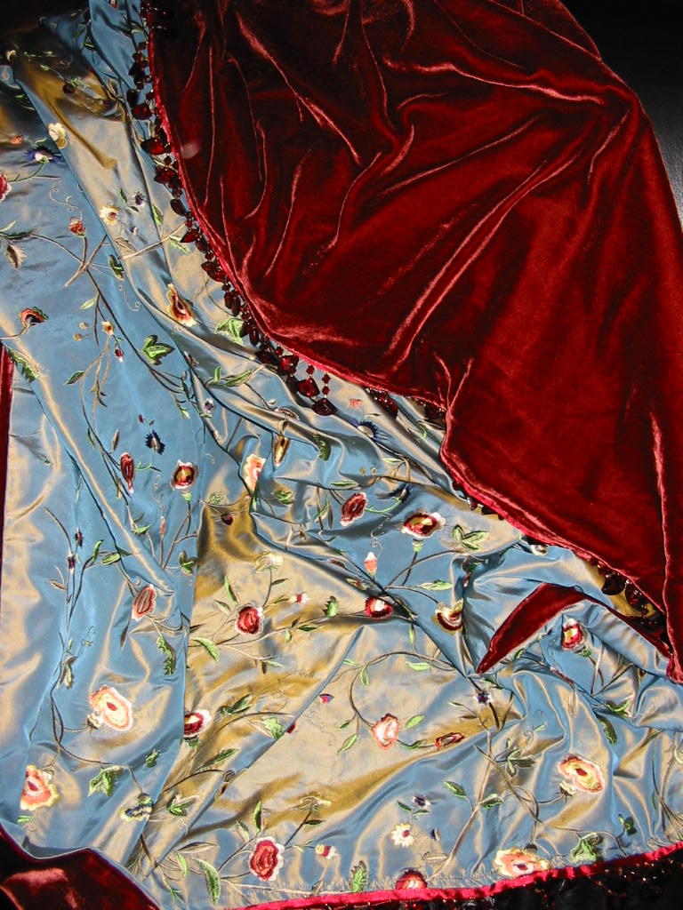 Embroidered Silk Taffeta in Hothouse Flowers Blue backed in Sunset Strip Silk Velvet and finished in Glass Fan Beads