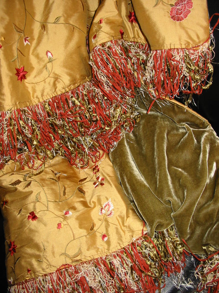 Embroidered Silk Dupioni backed in Sunset Strip Silk Velvet in Olive and finished in Eyelash Fringe
