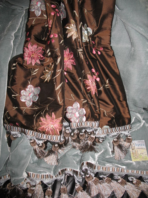 Embroidered Silk Dupioni in Chocolate Arcadia backed in Sunset Strip Silk Velvet in Azzurro and finished in Tassel Trim