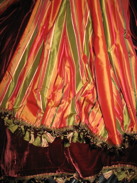 Striped Silk Taffeta in Mauricio Fruit Stripe backed in Sunset Strip Silk Velvet in Cranberry and finished in Tassel Trim
