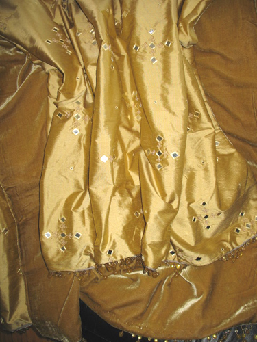 Mirrored Silk Dupioni backed in Sunset Strip Silk Velvet in Gold and finished with Beaded Trim