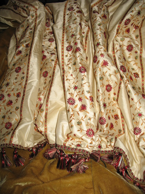 Embroidered Flowers on Silk Dupioni backed in Sunset Strip Silk Velvet in Camel and finished with Tassel Trim