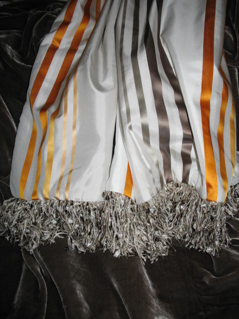 Striped Silk Taffeta in Fantasy Orange, Grey & White backed in Sunset Strip Silk Velvet in Concrete and finished with Fringe Trim