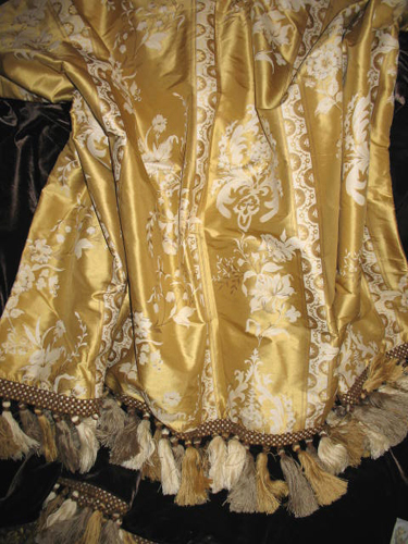 Painted Silk Dupioni backed in Sunset Strip Silk Velvet in Chocolate and fhinshed in Tassel Trim