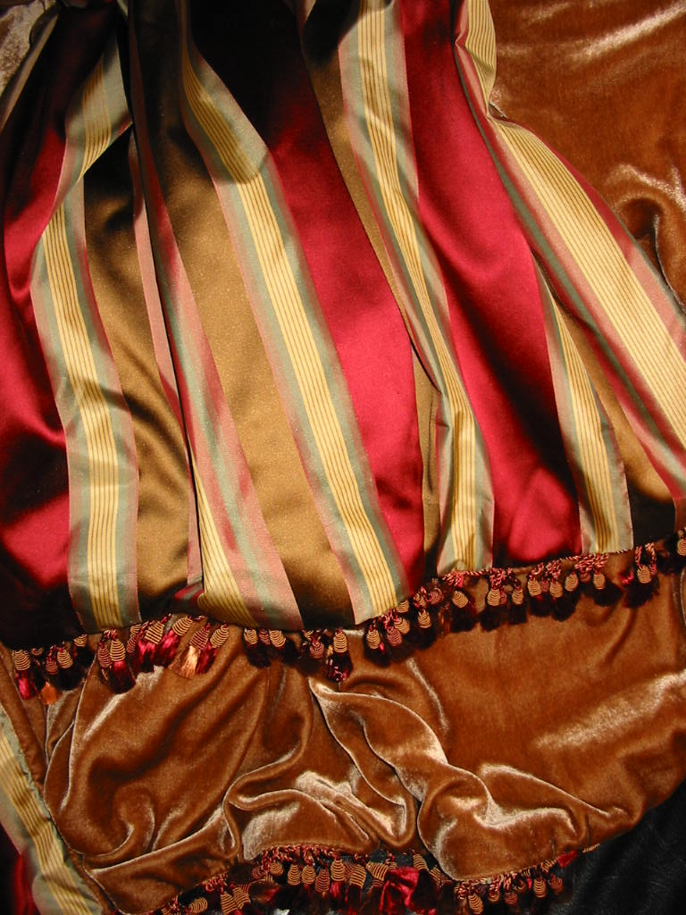 Striped Satin Silk in Ruby Falls backed in Sunset Strip Silk Velvet in Sienna and finished in Glass Bead and Tassel Trim