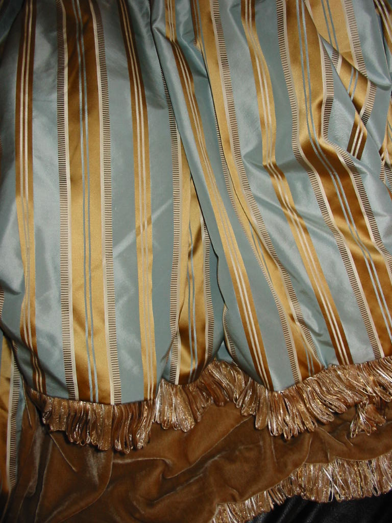 Striped Silk Taffeta in Oval Office Blue backed in Sunset Strip Silk Velvet in Camel and finished in Loop Fringe